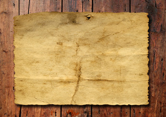 Old paper over an old wood background