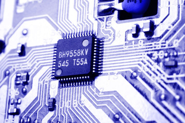 Microchip on circuit board, blue toned.