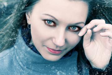 Young frozen girl in winter