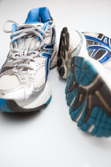 Pair of running shoes on a white background. (shallow DOF; color