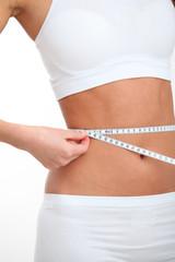 Closeup of tape measure around woman waist