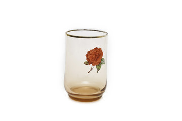 with a glass of rose decoration on white background