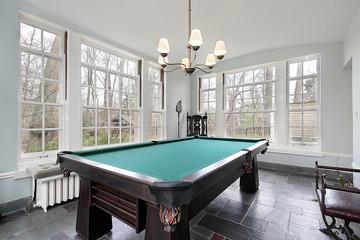 Pool table in sunroom