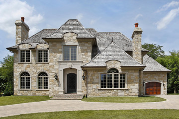 Luxury stone home with arched entryway