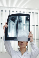 female doctor with radiograph