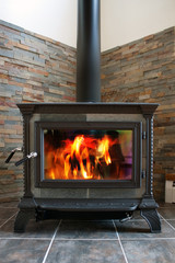 Wood Stove burning fiery hot for affordable home heating