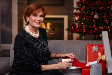 Senior woman wrapping christmas presents