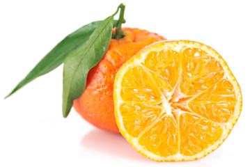 Ripe tangerines with leaves over white background