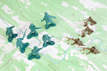 Plastic Army Men Fighting on Topographic Map General's View