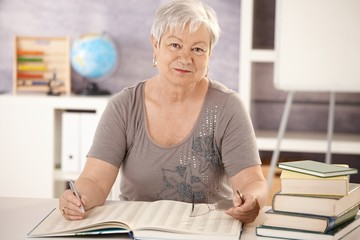 Portrait of senior teacher working