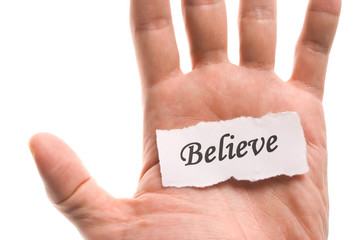 Believe word in hand