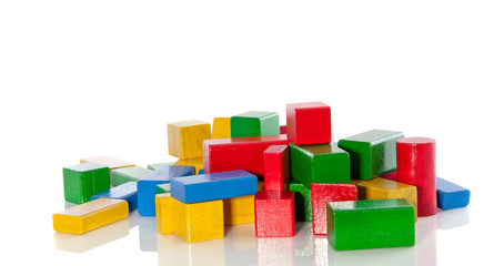 colorful wooden toy bocks isolated over white