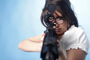 Sexy woman aiming an assault rifle