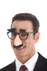Smiling Businessman Wearing Groucho Marx Glasses Isolated White