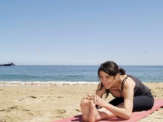 Bikram yoga sit-up pose at beach
