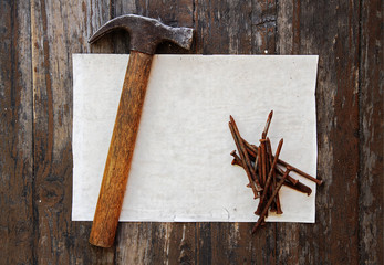old rusty nails, hammer and paper