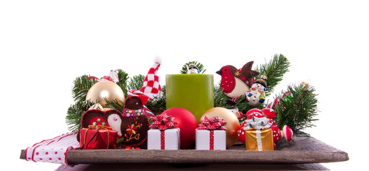 cheerful christmas plateau with candles balls and gifts  isolate