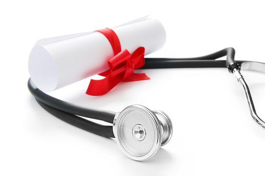 Education concept with diploma and stethoscope on white