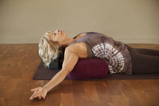 Woman On Yoga Bolster