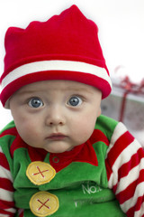 Baby at christmas with present