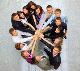 view of business people with their hands together in a c