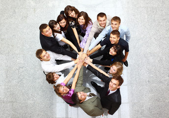 Top view of business people with their hands together in