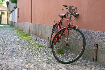 Red bicycle against a wall