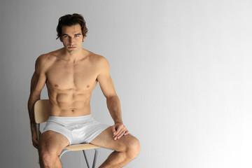 Sexy guy on stool