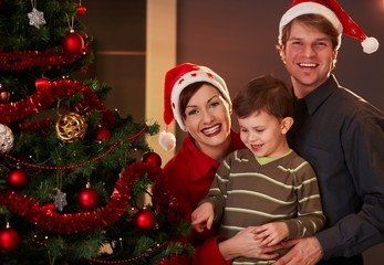 Parents and child at christmas