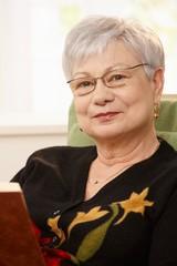 Closeup portrait of senior woman with book