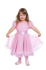 Little smiling girl in pink dress