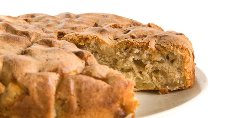 cinnamon apple pie with one piece cut out, on a plate;