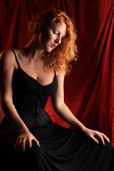beautiful redhead girl in black dress