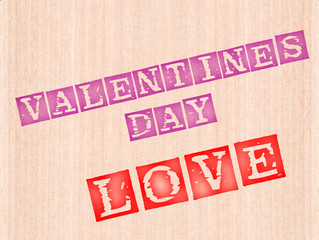 Valentins day and love word stamped on wooden