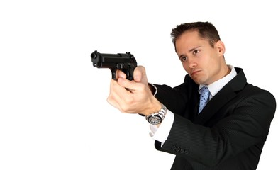 A Secret Agent taking aim with his pistol