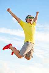 Happy young man jumping in the sky