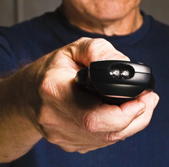 older man holding tv remote control