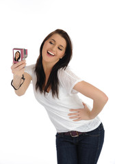 beautiful casual woman taking her own pictures on a digital phot