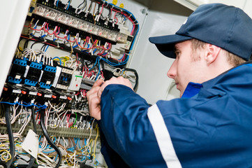 Electrician at voltage adjusting work