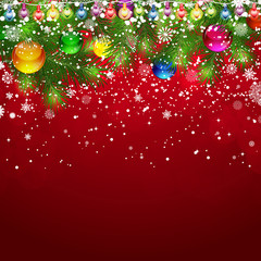 Christmas background with snow-covered branches of Christmas tre