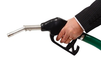 Hand holding gas nozzle