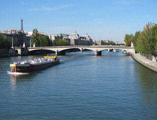 View of the Louvre Museum and Eiffel Tower at the Seine River