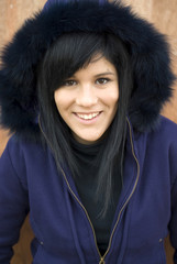Teenage girl outdoors in fur hood