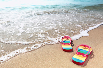 Flipflops on a sandy ocean beach