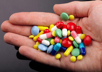 Hand with colorful pills