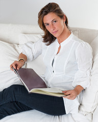 Attractive brunette reading a book