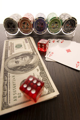 Red casino dice on dollars