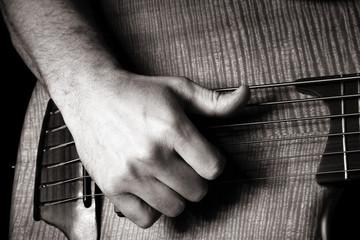 playing six-string electric bass guitar; slap technique