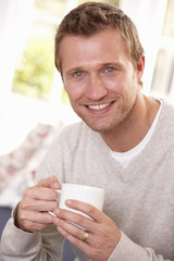 Man drinking from cup