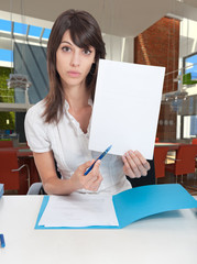 Young business woman with blank document